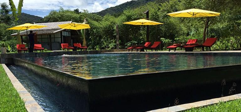 Muang La Resort creates a unique river-island swimming pool  in remote Laos